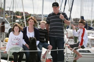 Grace, Sally, Charley, Patrick and Jack Foot with their dog Lizzie on the boat at West Park Marina in Hobsonville. Photo / Sarah Ivey