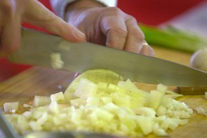 Stirring onions and garlic in the pan at the beginning of a dish is ok. Photo / Hawkes Bay Today