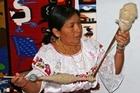 Luzmila Ruiz transforms wool into thread by hand. Photo / Jim Eagles