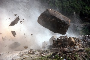 A huge boulder crashes across the mountain road before tumbling to the valley floor beyond. Photo / Brian Walker