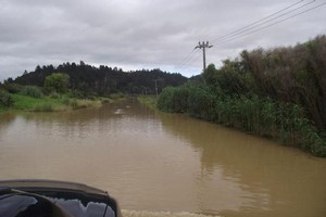 A Kaeo road is completely submerged. Photo / Clare Farrell
