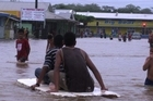 Children playing in the Apia floodwaters. Photo / Cherelle Jackson