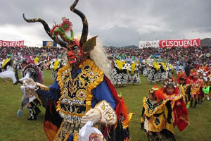 Dancers sporting false heads that caricature figures from Peruvian myth and history perform at the Candelaria dance and costume contest in Puno, south-eastern Peru. Photo / Wikimedia Commons image by user Aldoz
