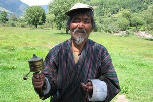 A man holds his prayer wheel. Photo / Jill Worrall