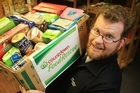 Salvation Army regional Director Jason Dilger with some of Countdown's donations to Salvation Army foodbanks. Photo / Greg Bowker