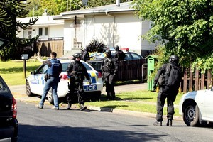 Police and armed offenders surround a house in Tokoroa yesterday. Photo / Janna Dixon