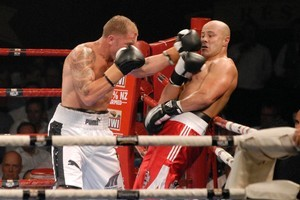 Shane Cameron (left) fights Monty Betham in last night's main event. Photo / Michael Craig