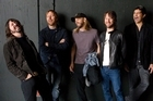 The Foo Fighters, from left, Dave Grohl, Nate Mendel, Taylor Hawkins, Chris Shiflett and Pat Smear. 'We show up in a town and it would be like, 'Oh, the f***** Foo Fighters are here again.'' - Nate Mendel. Photo / AP
