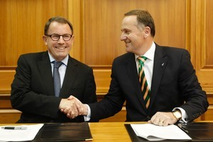 Act leader John Banks and Prime Minister John Key shake hands after signing their governing arrangement at Parliament today. Photo / Mark Mitchell