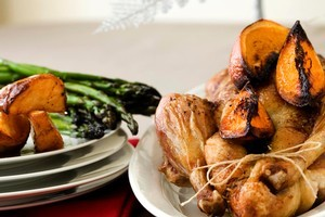 Roast duck, crisp potatoes and asparagus. Photo / Babiche Martens
