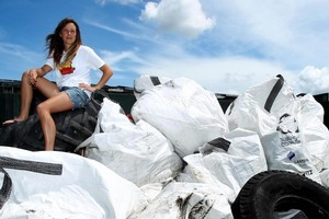 Mitzi Borren, of Sustainable Coastlines, with almost 3 tonnes of rubbish removed from Rangitoto Island by volunteers and school children. Photo / Janna Dixon