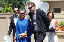 Ali Williams (right), his partner, Casey Green (in blue), and other guests leave their hotel. Photo / Mark Mitchell