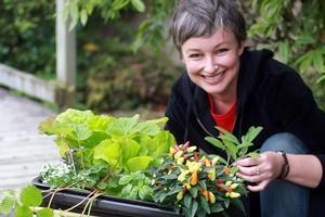 Meg Liptrot with her self-watering planter. Photo / Doug Sherring
