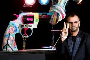 Ringo Starr unveils his 'knotted gun' statue. Photo / AP