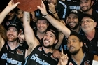 The Breakers celebrate their win over the Cairns Taipans in the grand final series decider in Auckland. Photo / Sarah Ivey