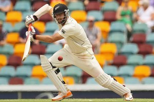 Daniel Vettori ran himself out on 96 at Brisbane, but he says his batting skills are improving as he keeps working on them. Photo / Getty Images