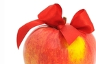 Up your intake of fruits like apples to prevent feeling bloated from indulging in the festivities. Photo / Thinkstock