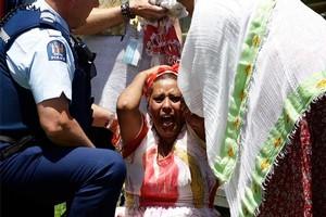 An Ethiopian woman grieves for fire victim Meme Woldeyesus. Photo / Sarah Ivey