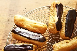The recipe for these chocolate eclairs can be found in The Art of French Baking. Photo / Supplied