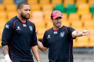Former rugby league player Andrew Johns gives instruction to Manu Vatuvei. Photo / Dean Purcell