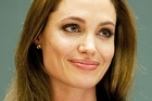 Angelina Jolie and her father Jon Voight have such a troubled past they can't talk about it. Photo / Getty