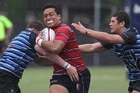 Kelston's Kirby Tavita splits the Nelson College defence, Michell Drummong (left) and Mitchell Hunt. Photo / Paul Estcourt