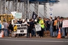 Port workers and their supporters stage a picket yesterday to press their case for a new collective contract. Photo / Dean Purcell