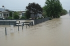 Flooded streets in the Nelson region. Photo / Tessa McBride