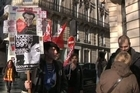 French trade unions demonstrate outside the headquarters of Moody's Investor Services in Paris - the U.S. credit rating agency that has put the euro zone under review.