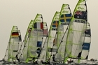 Competitors jostle for position at the start of the 49er Men's Skiff race. Photo / Getty Images