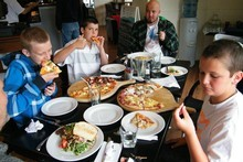 Daniel and his brothers enjoy a meal at Havelock's Slip Inn. Photo / Supplied 