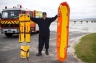 Shelly Beach volunteer fireman Adam Knezovich with types of rescue gear the organisation will buy with the money. Photo / Paul Estcourt