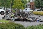 The remains of a work van are strewn across Stadium Circuit in Mulgrave, Melbourne. Photo / AAP