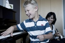 Ryan Herbert plays the piano at the Raukatauri Music Therapy Centre in Grey Lynn. Photo / Supplied