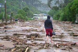 Debris left by the tsunami-like Nelson flooding. Photo / Paul Altabas