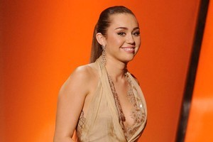 Miley Cyrus walks onstage at the first annual American Giving Awards, in Los Angeles. Photo / AP