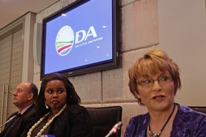 Democratic Alliance new parliament leader Lindiwe Mazibuko, center, listens as Democratic Alliance leader Hellen Zille, right, speaks in Cape Town, South Africa. Photo / AP