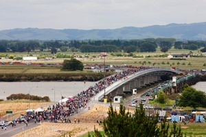Pedestrians walk over the Kopu Bridge at the opening on Saturday. Photo / Christine Cornege