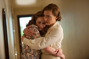 Kate Winslet (right), here with Evan Rachel Wood, is wonderfully restrained in the title role of Mildred Pierce. Photo / Supplied