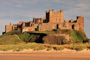 Bamburgh Castle stands proudly above  a treacherous sea, and has protected  both its inhabitants and hapless  sailors for hundreds of years. Photo / Supplied