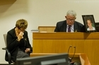 Pike River victim Michael Monk's photo is displayed as his parents, local publicans Bernie and Kath Monk, appear before the Royal Commission into the Tragedy. Photo / The Press