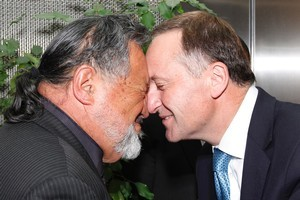 Prime Minister John Key hongis with Maori Party co-leader Pita Sharples. Photo / Mark Mitchell