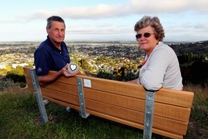 Simon and Cathy Cowan have put a seat on Sugar Loaf Reserve overlooking Napier, in memory of their son Phil. Photo / APN