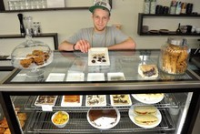 Walter Hill shows off some of the sweet treats at Ciocco Coco Cafe in Wellington's Willis St. Photo / Supplied