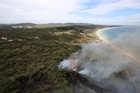The 40 hectare scrub fire destroyed at least two homes and forced five people to flee into the water at Matai Bay on Karikari Peninsula, 40km north-east of Kaitaia. Photo / Petrina Hodgson
