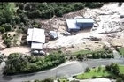 View the extent of the damage wreaked by the Nelson floods from a helicopter.