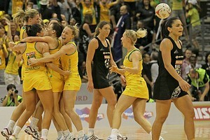 Australian players celebrate victory over New Zealand during the final. Photo / Getty Images