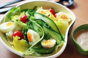 The classic Kiwi salad receives a modern twist with cherry tomatoes and cucumber ribbons. Photo / Doug Sherring