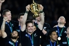 Richie McCaw lifts the Rugby World Cup. Photo / Michael Cunningham