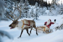 How does one man and a band of reindeer make it around the globe and down everyone's chimney in one night? Photo / Thinkstock